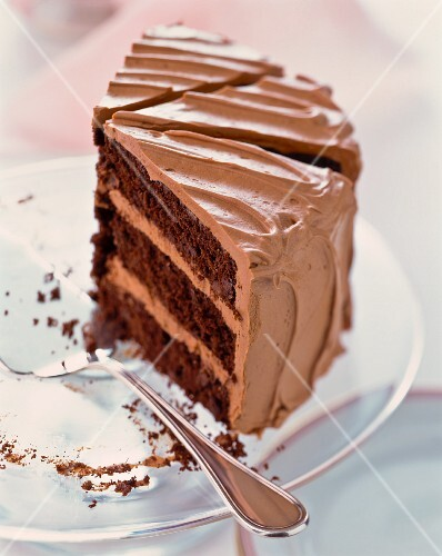 Three slices of chocolate cream cake on a cake plate