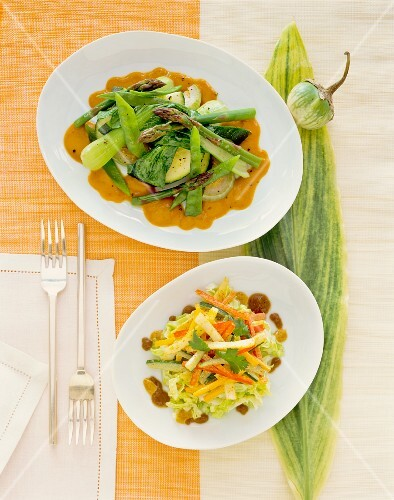 Asparagus with aubergines and spring onions with a vegetable salad