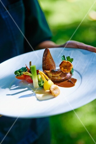 Pigeon breast with a side of vegetables
