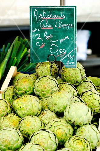 Artichokes with a price label at a market in France
