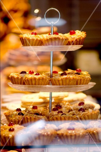 Cherry frangipane cakes in the window of a bakery