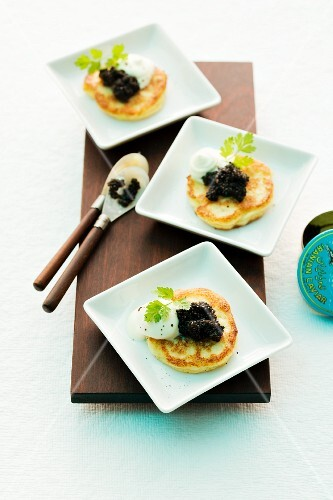 Baked cauliflower blinis with caviar and crème fraîche