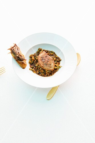 Duck liver on a bed of lentils