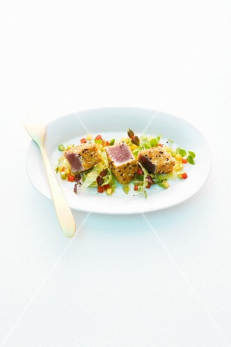 Tuna fish on a bed of vegetables