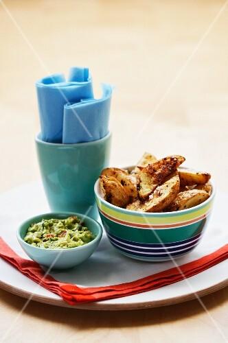 Potato wedges and guacamole