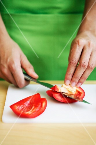 A pepper being deseeded
