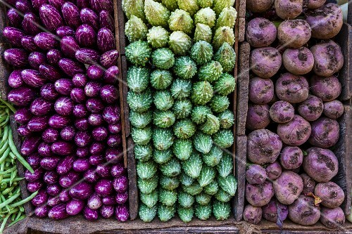 Aubergine, bitter gourds and beetroot on a market stall