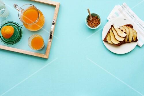 Breakfast with orange juice and pears on toast