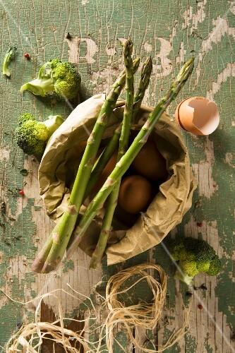 An arrangement of eggs and green vegetables
