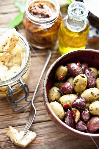 Italian antipasti: marinated olives, artichoke hearts and dried tomatoes