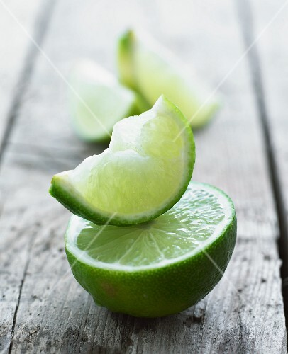 A lime half and a lime wedge