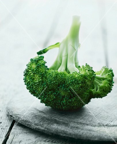 Broccoli on a wooden plate