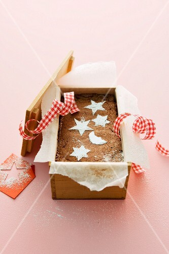 Christmas chocolate cake baked in a wooden box