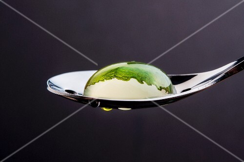A Mojito bubble on a spoon (close-up)