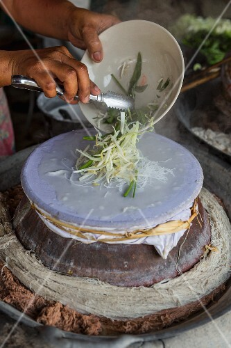 Steamed rice paper rolls with vegetables being made (Thailand)