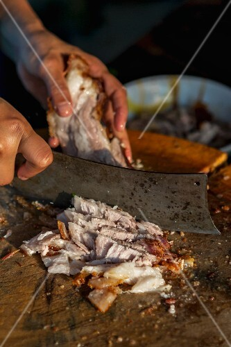 Roast pork being chopped (Thailand)