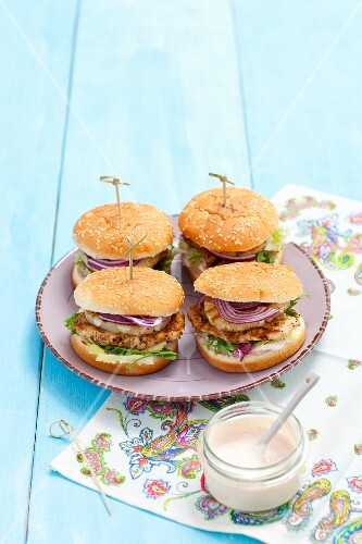 Mini hamburgers with chicken, pineapples and onions