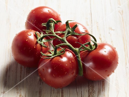 Freshly washed tomatoes on a wooden surface