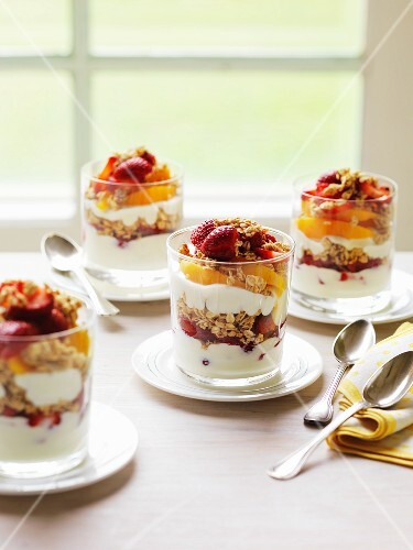 Layered desserts with parfait, fruit and muesli