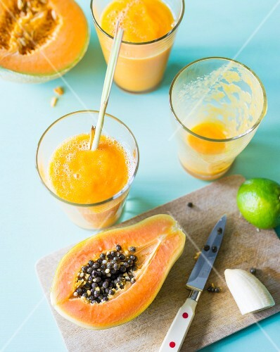 Tropical smoothies made with papaya, melon, banana and lemongrass
