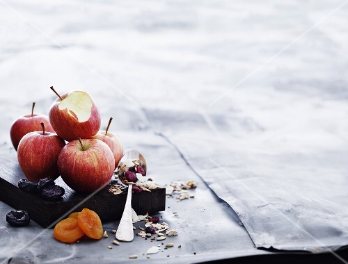 An arrangement of apples, dried fruits and muesli