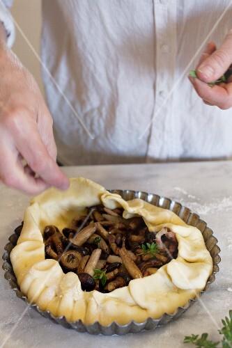 An unbaked mushroom pie