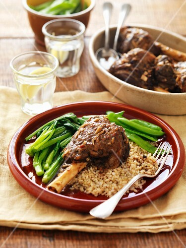 Marinated leg of lamb with green vegetables on a bed of millet risotto