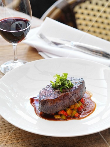 Beef steak on a bed of ratatouille