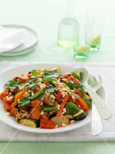 Sweet and spicy oven-roasted vegetables with fresh herbs