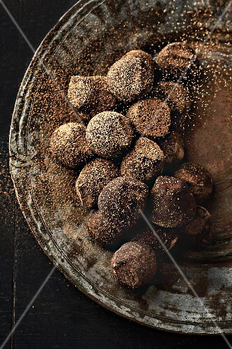 Chocolate truffles and maple syrup truffles on a plate
