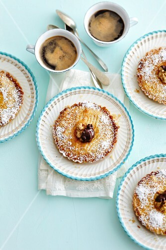 Engadine nut cakes with cups of coffee
