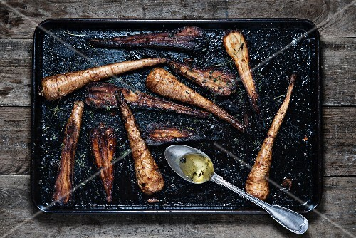 Roasted parsnips on a baking tray