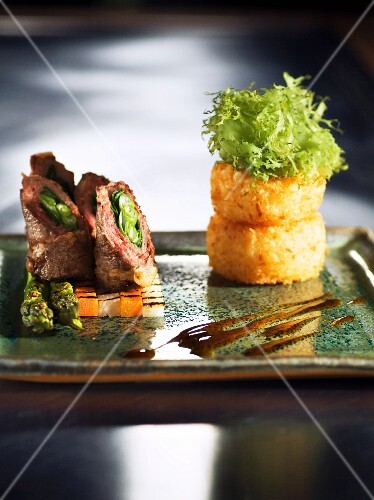 Fried rice cakes with negi-maki on a bed of vegetables