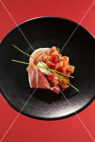 Serrano ham with diced tomatoes