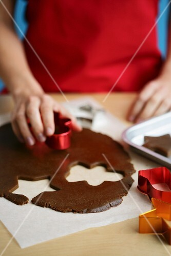 Gingerbread biscuits being cut out