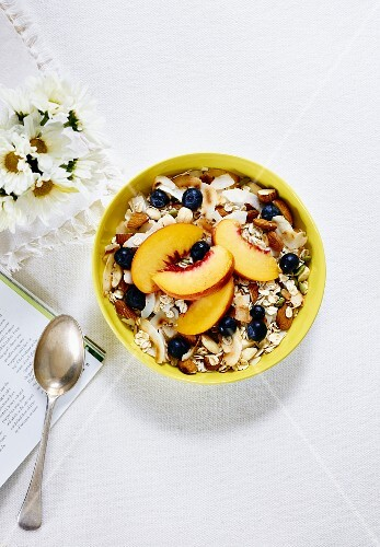 Muesli with blueberries and peaches