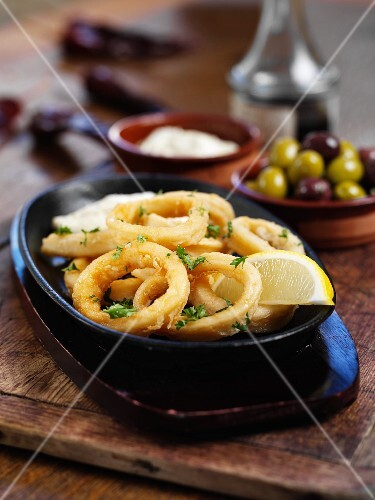 Fried squid rings with lemons and olives (Spain)