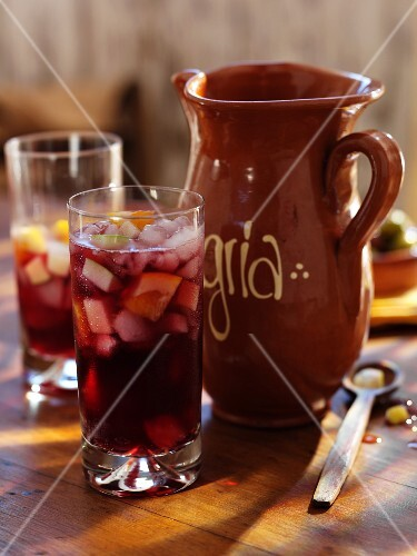 Sangria in glasses and an earthenware jug