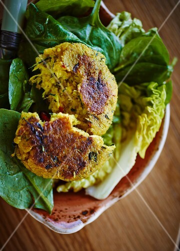 Couscous and courgette cakes on a bed of lettuce