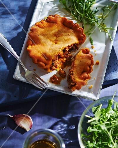 Tielle de sete (fish pie with squid, octopus and tomato sauce)