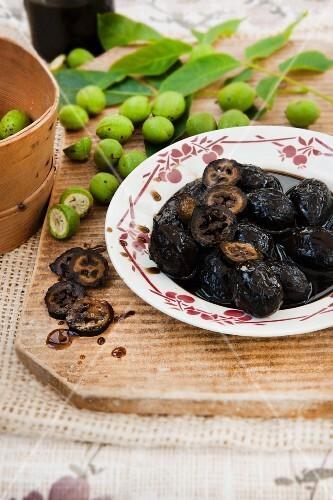 Black nuts in sugar syrup