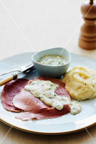 Corned beef with mashed potatoes and a herb sauce