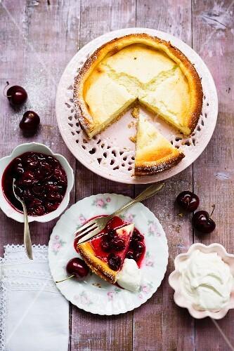 Cheesecake with cherries and cream