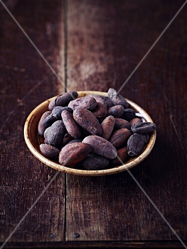 Cocoa beans on a ceramic plate