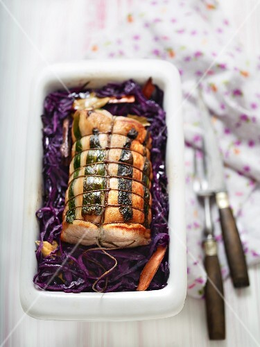 Pork roulade on a bed of red cabbage with cinnamon