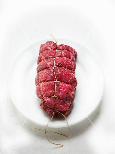 Raw beef roulade tied with kitchen twine