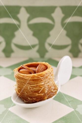 A Turkish almond cake on a canapé spoon