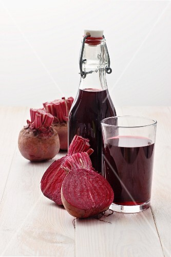 A bottle and a glass of beetroot juice