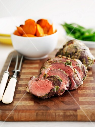 Leg of lamb with a herb crust and oven-roasted vegetables