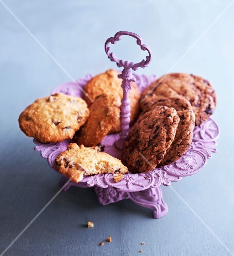 Chocolate chip cookies on a purple cake stand